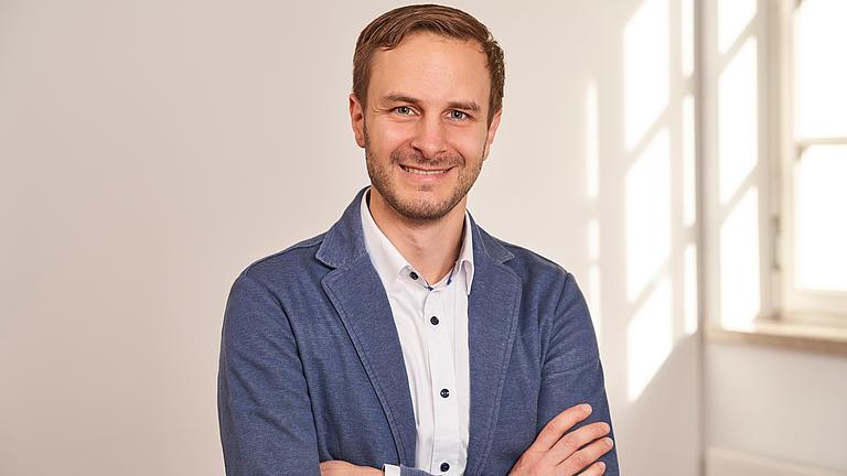 Ein Porträtfoto von André Meidenbauer