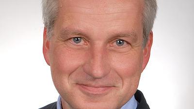 Ein Porträt-Foto von Dr. Frank Wissing