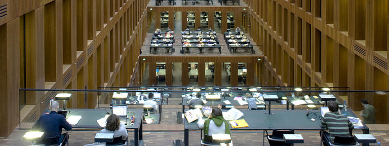 Students in a very big library.